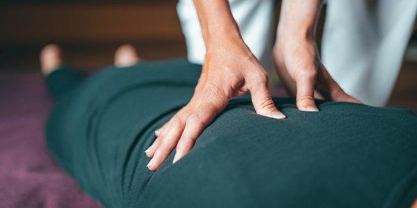 Massage Therapist giving massage